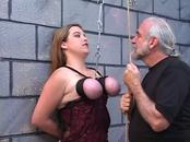 Dom puts rope around submissive sluts tits and pinches her nipples