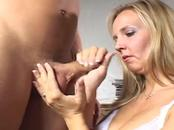 Hot blonde babe gives head to a juicy hard-on